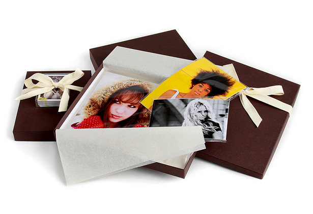 Photographic prints are sealed in clear poly bags wrapped in tissue paper.